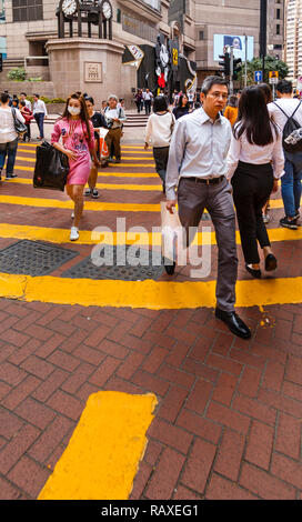 Pedestrian crossing near Times Square in Hong Kong - Stock Image