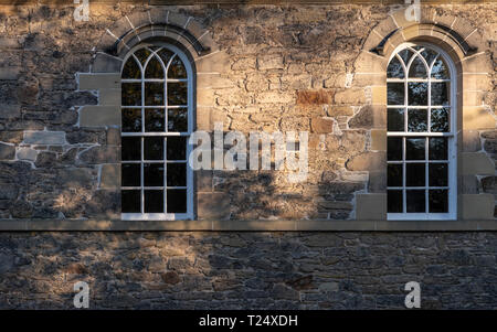 Norman arch on window in Kelso (c1800) old Parish Church with Georgian  sash panes. - Stock Image