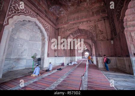People praying at the Jama Masjid mosque, Old Delhi, India - Stock Image