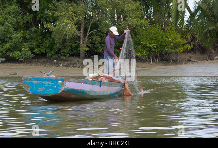 fisherman fishing in traditional way, Bako National Park, Bako, Sarawak, Borneo - Stock Image