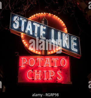 State Line, Potato Chips is an old factory neon sign. Shot at night time in Boston, preserved with others on Rose Fitzgerald Kennedy Greenway. - Stock Image