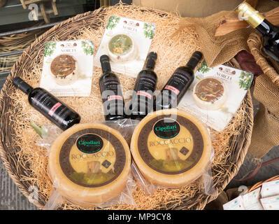 A wicker basket display of Melini San Lorenzo Chianti and regional cheeses, Pistoia, Tuscany, Italy, Europe - Stock Image