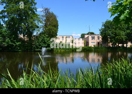 View across the lake to the buildings and huts at Bletchley Park, Milton Keynes, Buckinghamshire, UK. Now they hold exhibitions. - Stock Image