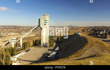 Ski Jumping Tower in Canada Olympic Park (COP) with City of Calgary, Alberta Downtown Skyline in the distance - Stock Image