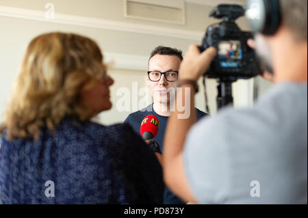 Stockholm, Sweden, August 7, 2018. Sweden Democrats unveil election posters. Communications Manager Joakim Wallerstein (SD) meets the press. Credit: Barbro Bergfeldt/Alamy Live News - Stock Image