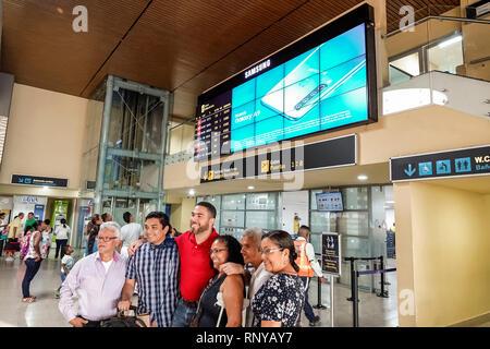 Cartagena Colombia Aeropuerto Internacional Rafael Nunez Airport inside concourse terminal departure gates Hispanic man woman boy teen family posing f - Stock Image