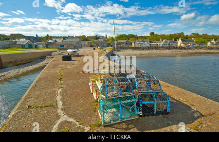 PORTGORDON MORAY SCOTLAND THE HARBOUR JETTY AND LOBSTER OR CRAB CREELS - Stock Image
