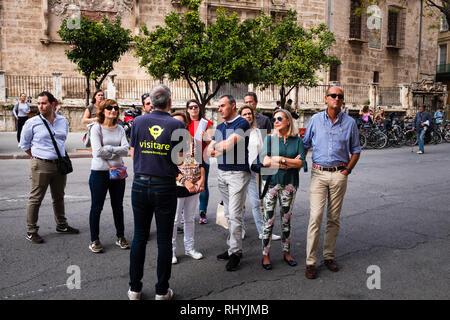Tourists on a walking tour of Valencia Spain - Stock Image