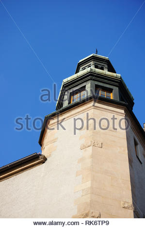 Poznan, Poland - February 6, 2019: Tower with windows of the historic Adam Mickiewicz university building and a blue sky in low perspective. - Stock Image