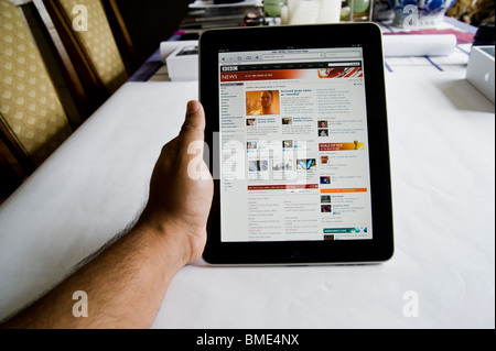 BBC News online on Apple iPad, TouchscreenTablet Computer, Book Reader, Digital Ebook, Modern, Logo, Brand, Luxury - Stock Image