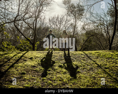Boy and girl cast shadows - Stock Image