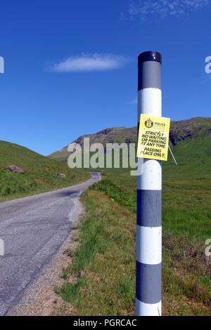 Passing place police sign - strictly no waiting or parking at any time notice on the single track roads on Mull, Inner Hebrides, Scotland - Stock Image