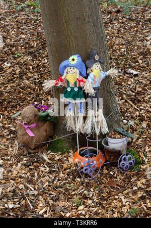 Sunflower rag dolls in woodland glade in crematorium - Stock Image