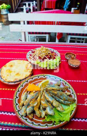 Grilled small fish, scad, salad, bread, Mehana Sozopol, old town, Sozopol, Bulgaria - Stock Image