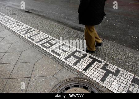 pavement sidewalk checkpoint charlie berlin germany deutschland travel tourism tiles unity in liberty pedestrian - Stock Image