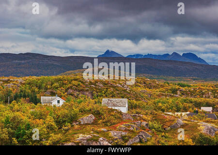 White cottages on island Senja in northern Norway on a windy day in autumn. - Stock Image