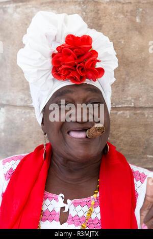 Cuba, Havana, Old Havana. Woman with cigar. Credit as: Wendy Kaveney / Jaynes Gallery / DanitaDelimont.com - Stock Image