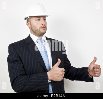 cheerful architect in suit on isolated background - Stock Image