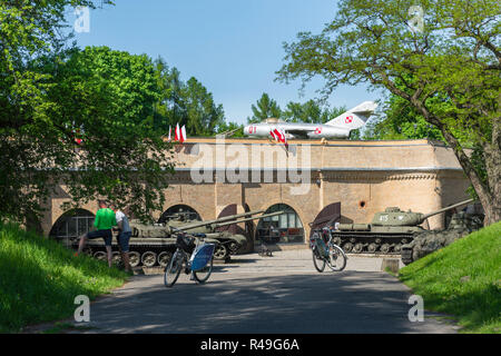 Poland Museum, exterior view of cold war era tanks and aircraft on display outside the Army Museum in Citadel Park in the city of Poznan, Poland. - Stock Image