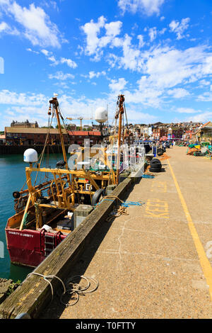 Work and fishing boats moored along side the quay, Scarborough harbour, North Yorkshire, England - Stock Image