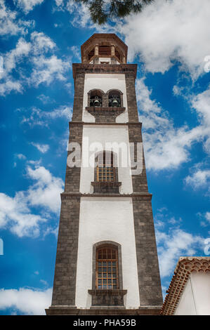 The tower of  Iglesia Nuestra Senora de La Concepcion, known the Cathedral of the city, Church of the Immaculate Conception, Santa Cruz de Tenerife - Stock Image