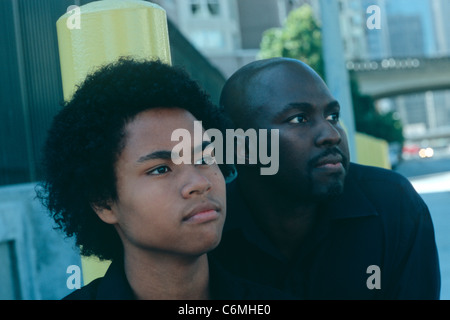 African American father and son in street setting - Stock Image