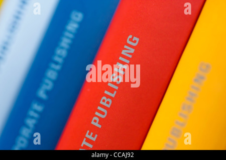 Colorful collection of annual reports in a row - Stock Image