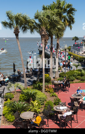 Tourists eating outside at Kemah boardwalk amusement park - Stock Image