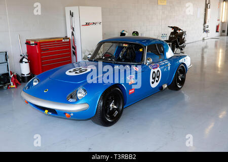 A stunning 1965 blue  Lotus Elan 26R,  in the International Pits, during the 2019 Silverstone Classic Media Day - Stock Image