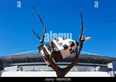 The Cow up a Tree sculpture in Melbourn Docklands.The Bovine themed sculpture was created in 1999 by the Australian artist John Kelly.It weighs four t - Stock Image