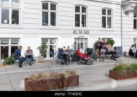 People outside Joe & The Juice, Sankt Annae Plads, Copenhagen, Denmark - Stock Image