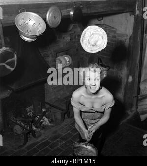 Mrs Richard Heane tossing a pancake on Shrove Tuesday 1951. February 1951 B608 -001 - Stock Image