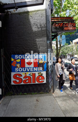 Two Chinese women walking past a souvenir store on Robson Street  in downtown Vancouver, BC, Canada - Stock Image