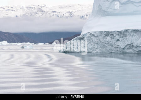 Scoresbysund, Greenland icebergs, fjords, snow-capped mountains - Stock Image
