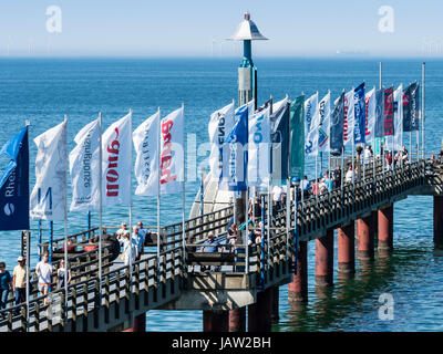 Wharf of Zingst, flags of companies which participate in exhibition and fotofestival  'Horizone',   Baltic - Stock Image