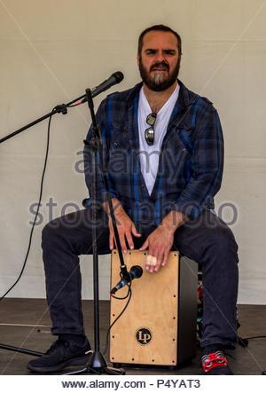 A bearded Cajon player entertains at Fleet Food Festival - Stock Image