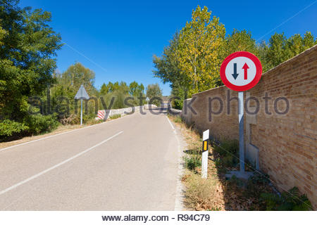 Spanish signal priority pass over oncoming vehicles in narrow rural road in Castile, Spain, Europe - Stock Image