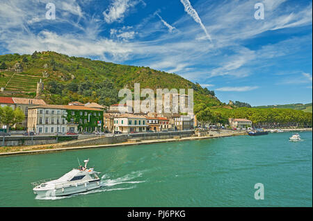 Boats on the River Rhone pass through Tournon sur Rhone in the Ardeche department, Rhone Alps region of France - Stock Image