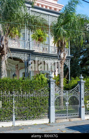 The ornate facade of Carroll-Crawford House, three-story Italianate house, cast iron balconies and fence, Garden District, New Orleans, USA. - Stock Image