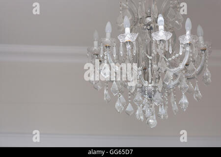 Close-up of a chandelier hanging from a ceiling - Stock Image