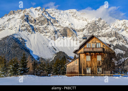 lonely hut in the alps with snow - Stock Image
