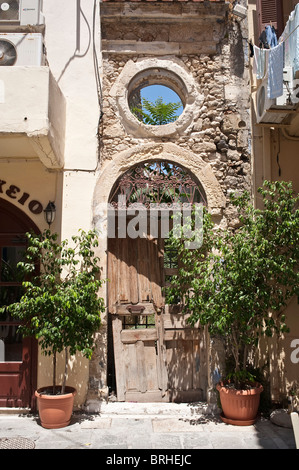 Dilapidated carved stone entrance with circular feature Rethymno Crete Greece - Stock Image
