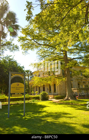 Lawn gardens building Steves Homestead museum is a historic house built 1876 San Antonio River San Antonio Texas - Stock Image