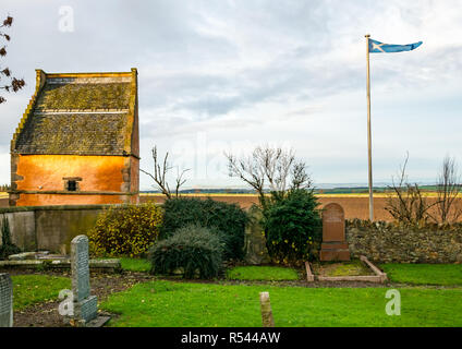 Athelstaneford, East Lothian, Scotland, United Kingdom, 29th November 2018.UK Weather:Birthplace of St Andrew's Cross, the saltire flag. On the eve of St Andrew's Day at the historic orange lime washed dovecot of the National Flag Heritage Centre. Legend says that on the eve of a battle between Picts and Angles from Northumbria in 832AD Saint Andrew had a vision of victory and when the Picts saw a white cross formed by clouds in a blue sky they attributed their victory to his blessing, adopting the cross as a flag - Stock Image