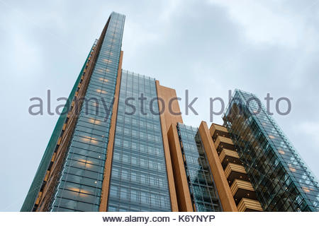 Germany, Berlin, Mitte. Low-angle view of office building against overcast sky. - Stock Image
