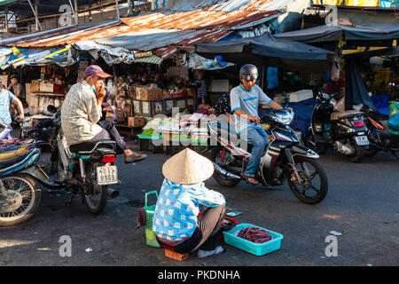 NHA TRANG, VIETNAM - AUGUST 06: A woman sells dried fish at the street market on August 06, 2018 in Nha Trang, Vietnam. - Stock Image
