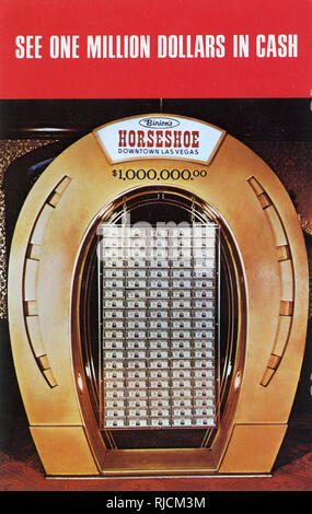 Binion's Horseshoe Club, Las Vegas, Nevada, USA -- one million dollars in cash on display in the form of one hundred ten thousand dollar bills, inside a giant golden horseshoe. - Stock Image