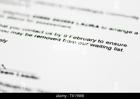 Hospital referral letter warning patient that they could be removed from the waiting list. - Stock Image