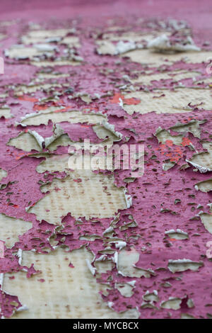 Macro photo of peeling painted surface of a fibreglass structure. Metaphor for hidden problems, under the surface, out of sight. Good paint texture. - Stock Image