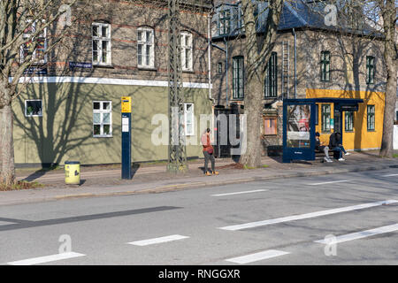 People at a bus stop, Øster Farimagsgade, Copenhagen, Denmark - Stock Image
